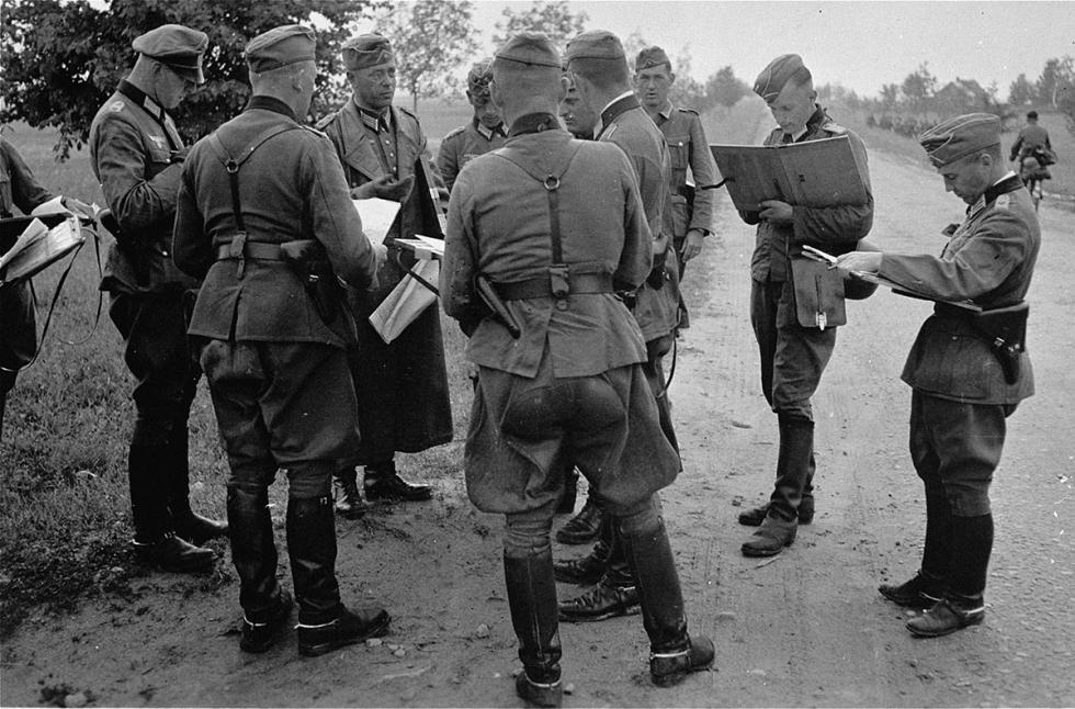 e28416aab76 German officers in the field consult with their commanding officer on their  orders of the day