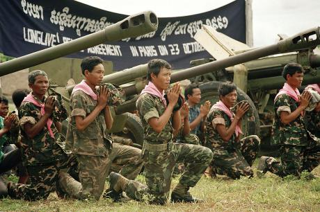Peace and monarchy return united states holocaust memorial museum a non communist resistance group pray for peace after surrendering their weapons as part of the demobilization of cambodian factions in 1991 platinumwayz