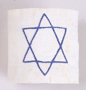White armband with blue Star of David