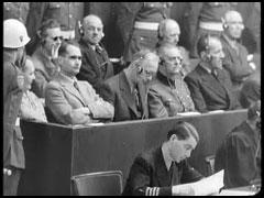 Defendant Hermann Goering listens to trial testimony