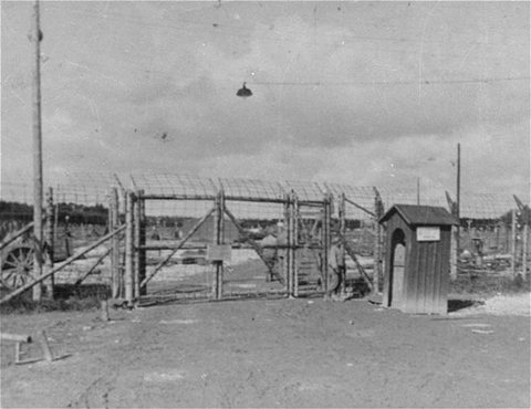 The entrance gate to Kaufering IV subcamp of Dachau. This photograph was taken after liberation. Near Landsberg, Germany, after April 28, 1945.