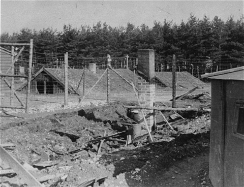 Barracks in the Kaufering IV subsidiary camp of the Dachau concentration camp. Before abandoning the camp, SS guards burned many of the barracks. Landsberg-Kaufering, Germany, after April 27, 1945.