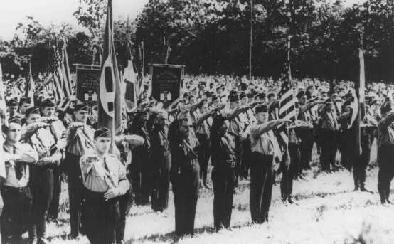 Members of the pro-Nazi German American Bund and the pro-Fascist Italian Blackshirts give the Nazi salute. This gathering took place at the Bund's Camp Siegfried on Long Island. Yaphank, New York, United States, October 16, 1937.