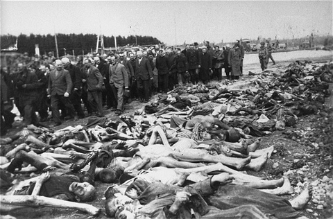 US troops force German civilians to view corpses of victims in the Kaufering IV subcamp of the Dachau concentration camp. Hurlach, Germany, April 29–30, 1945.