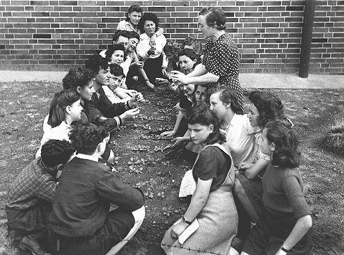 Jewish youth attend a class on transplanting seedlings, part of a general course in farming sponsored by the American Jewish Joint Distribution Committee at the Bergen-Belsen displaced persons camp. Germany, August 1, 1946.