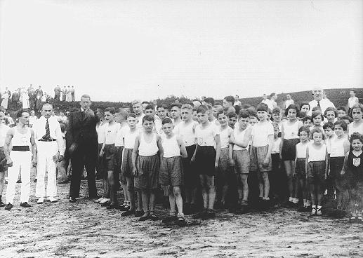 Jewish children gathered for a sporting event in a summer camp organized by the Reich Union of Jewish Frontline Soldiers. Germany, between 1934 and 1936.