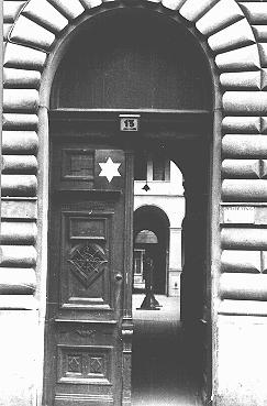 Entrance to the courtyard, marked with a Star of David, of a building designated for Jews. Budapest, Hungary, after April 2, 1944.