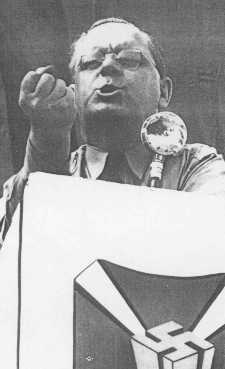 Fritz Kuhn, head of the antisemitic and pro-Nazi German American Bund, speaks at a rally. United States, between 1936 and 1939.