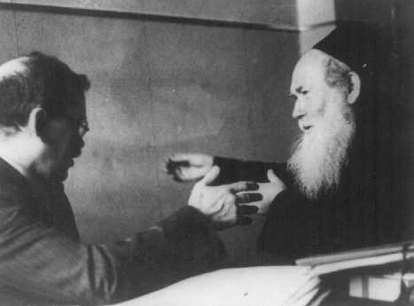 Yitzhak Gitterman (left), Joint Distribution Committee (JDC) director in Warsaw, meets with the representative of an Orthodox Jewish organization. Warsaw, Poland, date uncertain.