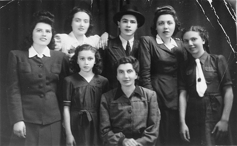 Group portrait of the Katz family. Pictured in the top row from left to right are: Chicha, Isabella, Philip, Jolon (Cipi), and Regina. In the bottom row are Helen (left) and Tereza. Munkacs, 1942–1943.