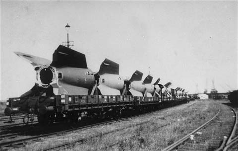 Sections of V-2 rockets, the so-called Vengeance Weapons, are removed by rail from the Dora-Mittelbau camp after liberation. Near Nordhausen, Germany, June 1945.