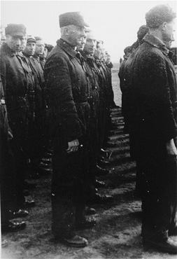 Roll call of the camp Jewish police. Westerbork transit camp, the Netherlands, 1942 or 1943.