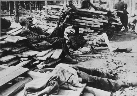 Survivors in Buchenwald just after liberation. Troops of the US 6th Armored Division entered Buchenwald on April 11, and troops of the 80th Infantry arrived on April 12. Buchenwald, Germany, photograph taken ca. April 11, 1945.