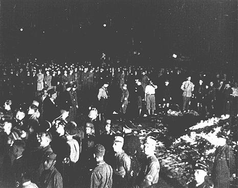 "At Berlin's Opernplatz, crowds of German students and members of the SA gather for the burning of books deemed ""un-German."" Berlin, Germany, May 10, 1933."