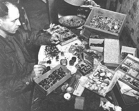 The valuables displayed here were confiscated from prisoners by German guards at the Buchenwald concentration camp and later found by American forces after the liberation of the camp. Buchenwald, Germany, after April 1945.
