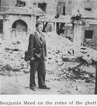 While living in hiding on the Aryan side of Warsaw, Benjamin Miedzyrzecki returns to the site of the Warsaw ghetto, where he poses among the ruins. Warsaw, Poland, 1944.