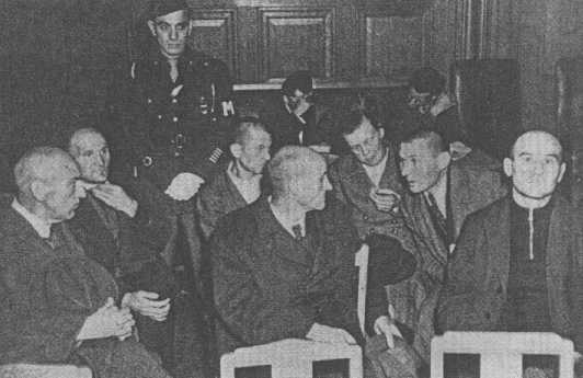 Staff from the Hadamar euthanasia center, including senior physician Adolf Wahlmann (front, left), during their trial. Wiesbaden, Germany, October 8-15, 1945.