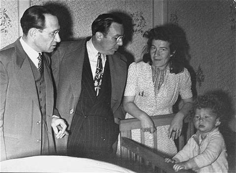 Joint Distribution Committee (JDC) representatives visit child care facilities at the Foehrenwald displaced persons camp. Among those pictured is Samuel Haber, director of JDC programs in the US zone from 1947 until 1954 (left). Foehrenwald, Germany, between 1945 and 1949.