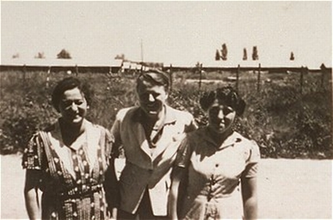 A woman (right) imprisoned in the Gurs camp stands with two Quaker delegates who worked for the American Friends Service Committee. Gurs, France, after January 1941.