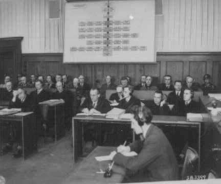 The defendants (back row) and their lawyers (front row) during the Pohl Trial. April 8, 1947.