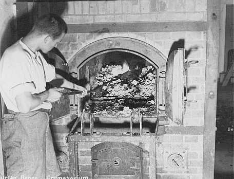 Human remains found in the Dachau concentration camp crematorium after liberation. Germany, April 1945.