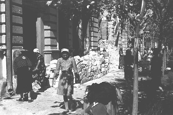 Jewish women at forced labor in the process of clearing rubble from the main street. Kishinev, Bessarabia, Romania, August 12, 1941.
