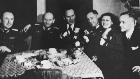 Oskar Schindler (third from left) at a party with local SS officials on his 34th birthday. Schindler attempted to use his connections with German officials to obtain information that might protect his Jewish employees. Krakow, Poland, April 28, 1942.