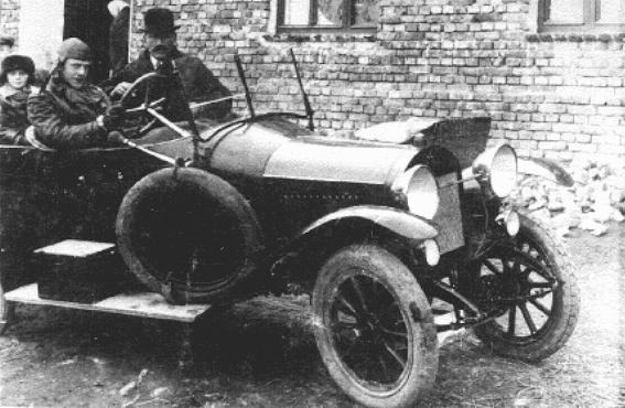 Oskar Schindler (at wheel) with his father, Hans. Svitavy (Zwittau), Czechoslovakia, 1929.
