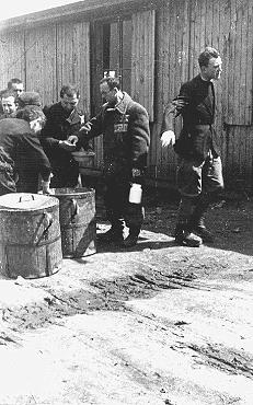 Prisoners receive meager food allocations at the Plaszow camp. Krakow, Poland, 1943 or 1944.