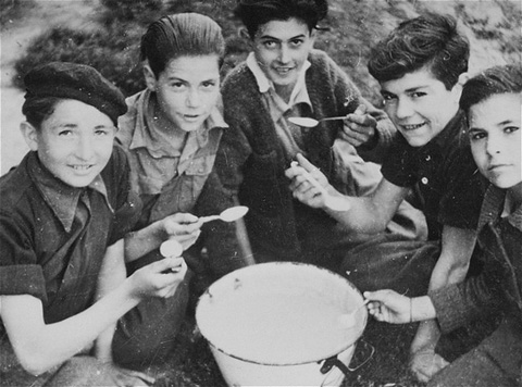 Spanish refugee children interned in the Gurs camp. These children often helped members of the American Friends Service Committee, a Quaker organization, in their relief work inside the camp. Gurs, France, 1943.
