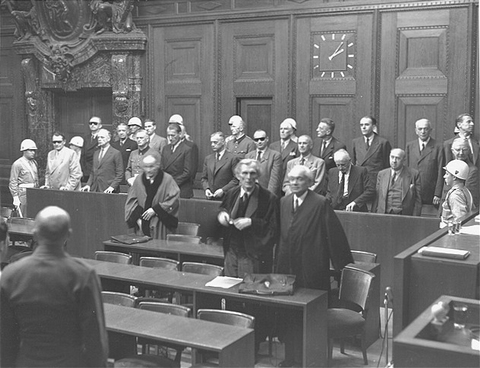 The defendants rise as the judges enter the courtroom at the International Military Tribunal trial of war criminals at Nuremberg.