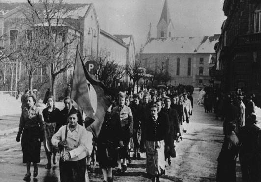 A parade of young Austrian women, members of the Nazi youth organization the League of German Girls (Bund Deutscher Maedel). Graz, Austria, February 20, 1938.