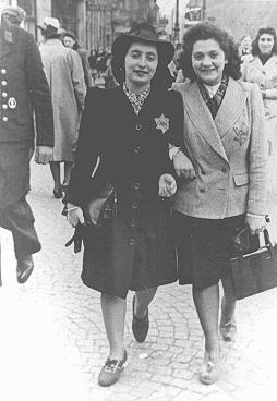 Rozetta Lezer Lopesdias-Van Thyn, left, and a friend, with the compulsory Star of David on their clothing. Amsterdam, the Netherlands, May 1942-1943.