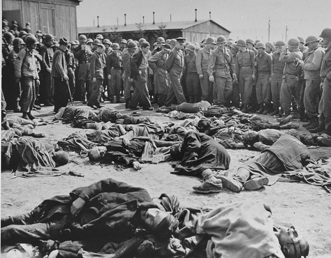 While touring the newly liberated Ohrdruf camp, General Dwight Eisenhower and other high ranking USArmy officers view the bodies of prisoners who were killed during the evacuation of Ohrdruf. Ohrdruf, Germany, April 12, 1945.
