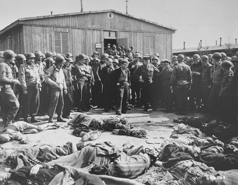 While on a tour of the newly liberated concentration camp, General Dwight Eisenhower and other high-ranking US Army officers view the bodies of prisoners who were killed during the evacuation of Ohrdruf. Ohrdruf, Germany  April 12, 1945.