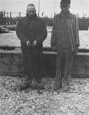 Two survivors of Kaufering, a network of subsidiary camps of the Dachau concentration camp. Landsberg-Kaufering, Germany, after April 27, 1945.