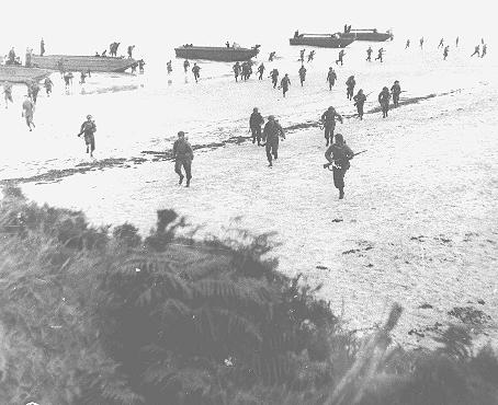 British troops land on the beaches of Normandy on D-Day, the beginning of the Allied invasion of France to establish a second front against German forces in Europe. Normandy, France, June 6, 1944.