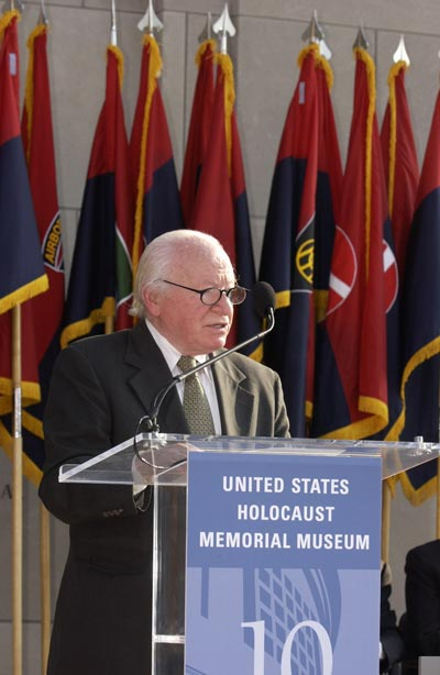 Standing in front of flags of the liberating divisions, Ben Meed, President, American Gathering of Jewish Holocaust Survivors, speaks at a ceremony held during the Museum's Tribute to Holocaust Survivors: Reunion of a Special Family, one of the Museum's tenth anniversary events. Washington, DC, November 2003.