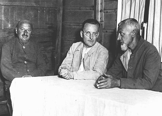 Social Democratic political prisoners in the Duerrgoy concentration camp near Breslau. Seated in the center is Paul Loebe, a leading Socialist and former president of the German parliament. Duerrgoy camp, Germany, August 4, 1933.