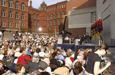 Scene during a ceremony held as part of the Museum's Tribute to Holocaust Survivors: Reunion of a Special Family, one of the Museum's tenth anniversary events. Flags of the liberating divisions form the backdrop to the ceremony. Washington, DC, November 2003.
