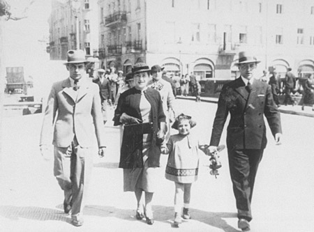A Jewish family walking down a street. Kalisz, Poland, May 16, 1935.