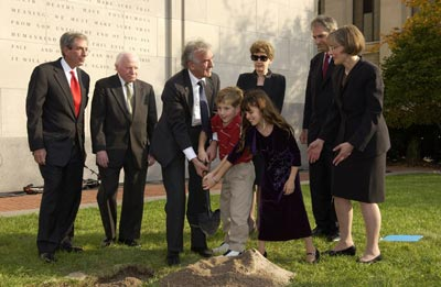 Benjamin Meed, Elie Wiesel (second and third from left), and two children bury a time capsule during the Tribute to Holocaust Survivors: Reunion of a Special Family, one of the Museum's tenth anniversary events. Washington, DC, November 2003.