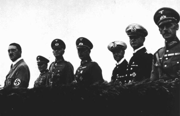 Adolf Hitler stands with his military high command at an inspection of German armed forces. From left to right: Hitler, Hermann Goering, Werner von Blomberg (armed forces), Erich von Fritsch (army) and Erich Raeder (navy). Germany, 1935.