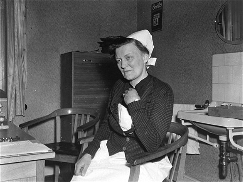 Portrait of Irmgard Huber, chief nurse at the Hadamar Institute, in her office. The photograph was taken by an American military photographer on April 7, 1945.