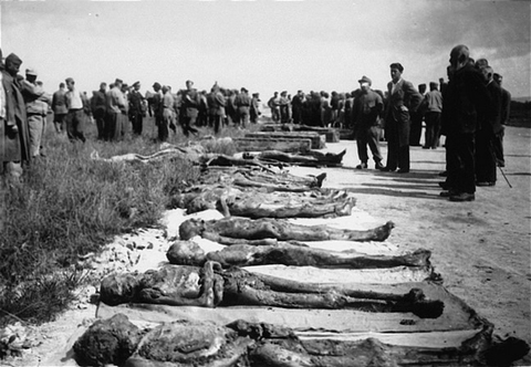 Local Germans are forced to view bodies of victims at Kaufering, a network of subsidiary camps of the Dachau concentration camp. Landsberg-Kaufering, Germany, after April 27, 1945.