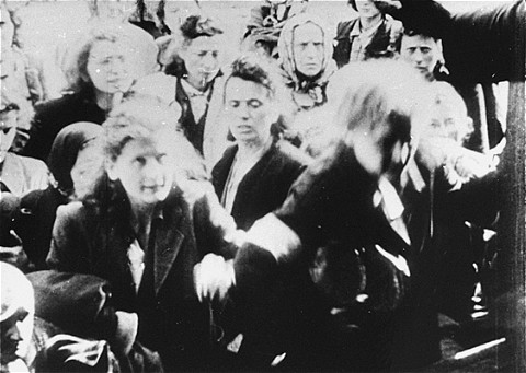 Jews being deported from the Warsaw ghetto are forced to board a freight train. Warsaw, Poland, July-September 1942.