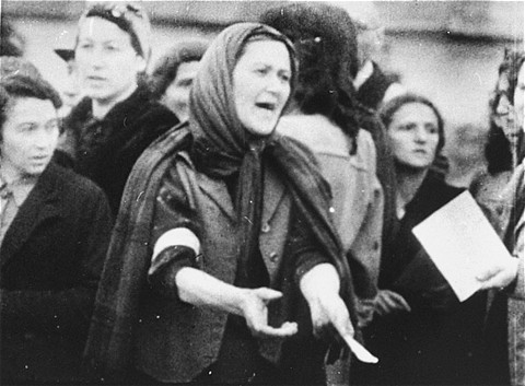 A Jewish woman during a deportation from the Warsaw ghetto. Warsaw, Poland, date uncertain.