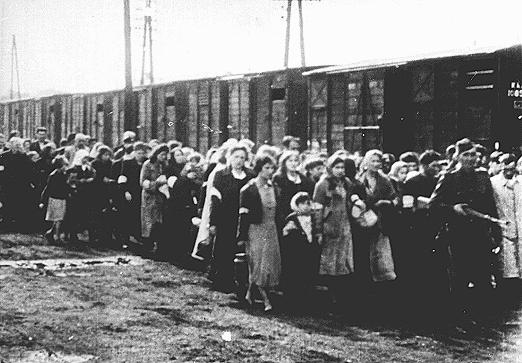 Jews being deported from the Warsaw ghetto march to the freight trains. Warsaw, Poland, July-September 1942.