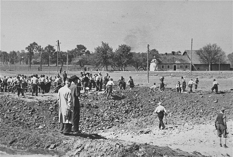 Austrian civilians prepare mass graves to bury former inmates in the Gusen concentration camp after American forces liberated the camp. Gusen, Austria, between May 5 and May 15, 1945.