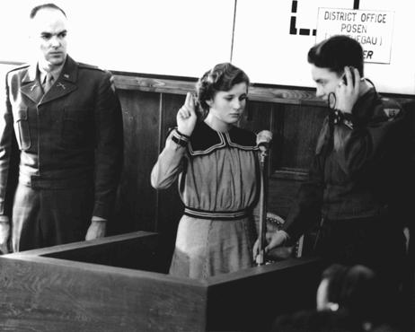 Fifteen-year-old Maria Dolezalova is sworn in as a prosecution witness at the RuSHA Trial. Dolezalova was among the children kidnapped by German forces after they destroyed the town of Lidice, Czechoslovakia. Nuremberg, October 30, 1947.